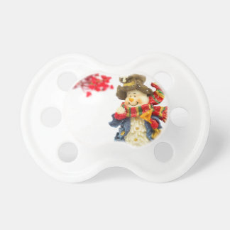Cute snowman figurine with red berries on white dummy