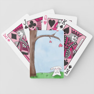 Cute white bunny sitting by a tree poker deck