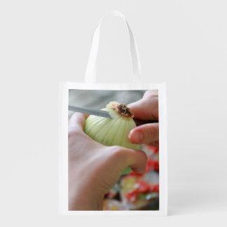 Cutting an onion reusable grocery bag