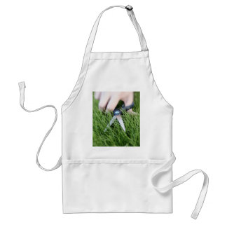 Cutting the grass with a pair of scissors standard apron