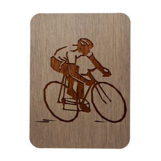 Cyclist silhouette engraved on wood design magnet