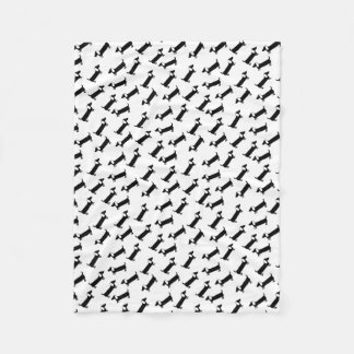 Dachshunds in black and white fleece blanket