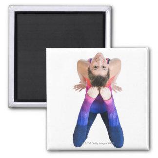 Dancer touching feet to head fridge magnets