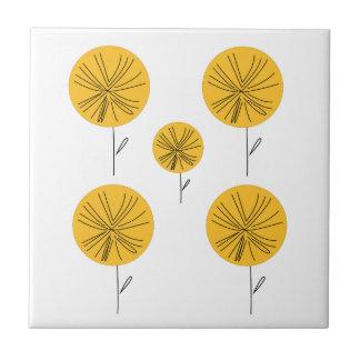 Dandelions gold on white ceramic tile