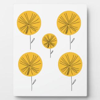 Dandelions gold on white plaque