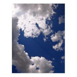 Dark clouds in the blue sky postcard