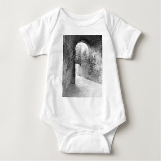 Dark corridors of an old fortification structure baby bodysuit