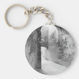 Dark corridors of an old fortification structure key ring