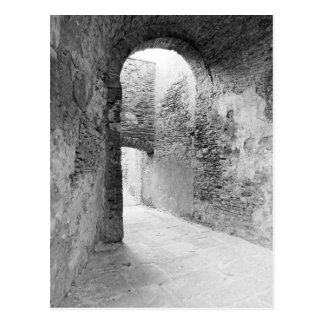 Dark corridors of an old fortification structure postcard