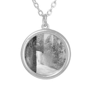 Dark corridors of an old fortification structure silver plated necklace