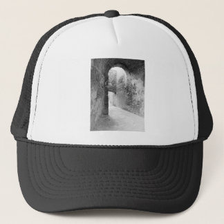 Dark corridors of an old fortification structure trucker hat
