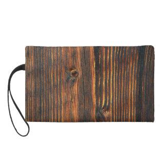 Dark orange wooden wall texture wristlet purses