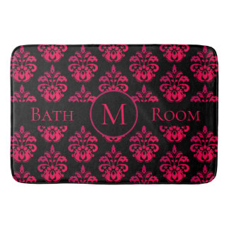 Dark pink monogram on black bath mat