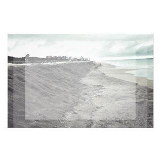 dark somber beach view stationery design