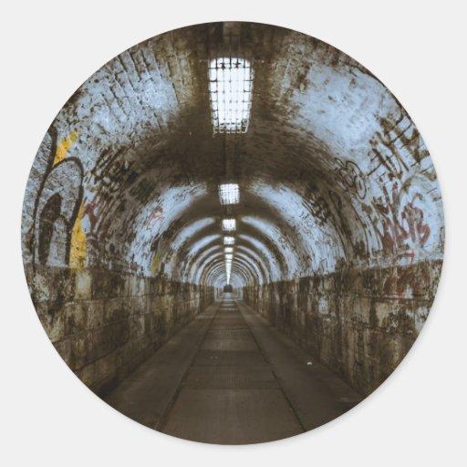 Dark underground tunnel round sticker