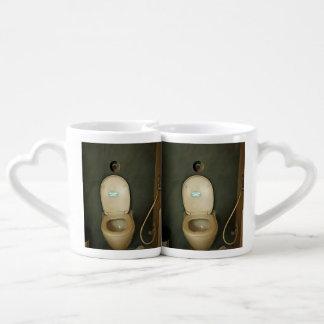 Darkened view of a commode couples mug
