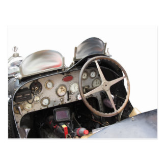 Dashboard and steering wheel of classic sport car postcard