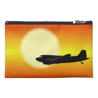 DC-3 passing sun Travel Accessory Bags