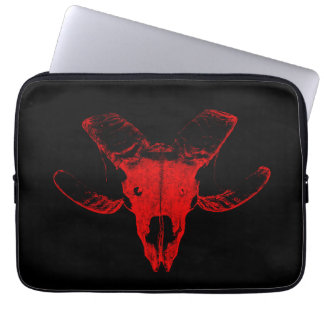 Dead head of the sheep on black laptop bag