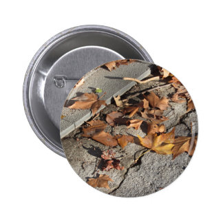 Dead leaves lying on the ground in the fall 6 cm round badge