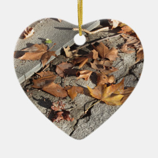 Dead leaves lying on the ground in the fall ceramic heart decoration