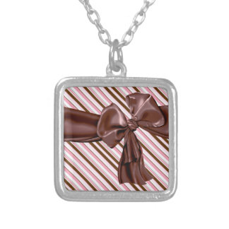 Decadent chocolate bow with stripes square pendant necklace