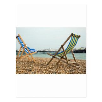 Deckchairs and shingle postcard