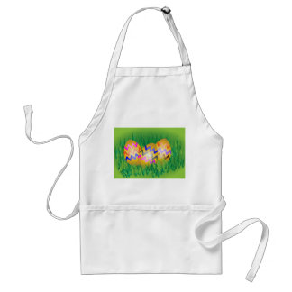 Decorated gold Easter eggs on grass Standard Apron