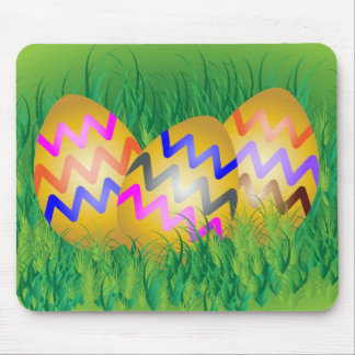 Decorated gold Easter eggs on grass Mouse Pad
