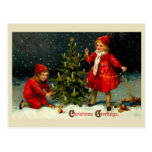 Decorating the Christmas tree-kids Post Card