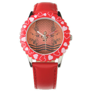 Decorative clef with roses an metal background wrist watch