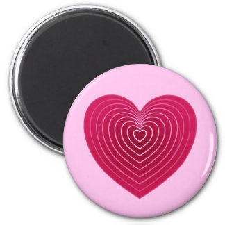 Deep rose red heart on a pale pink background magnet