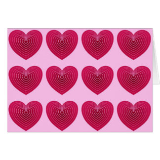 Deep rose red hearts on a pale pink background greeting card