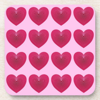 Deep rose red hearts on a pale pink background coasters