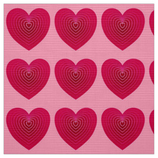 Deep rose red hearts on a pale pink background fabric