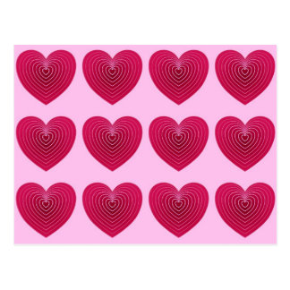 Deep rose red hearts on a pale pink background post cards