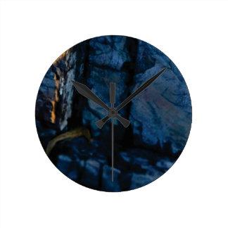 deep vertical cracks in rock round clock