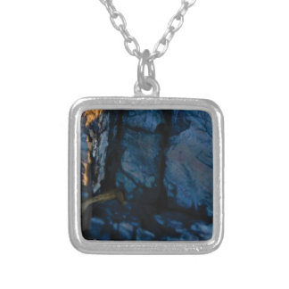 deep vertical cracks in rock silver plated necklace