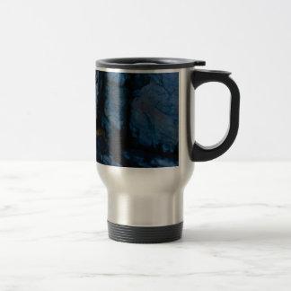 deep vertical cracks in rock travel mug