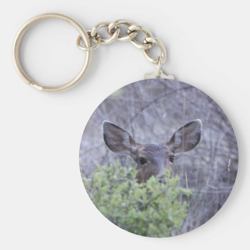 Deer hiding in bushes key chains