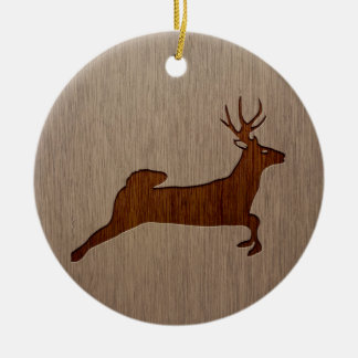 Deer silhouette engraved on wood design ceramic ornament