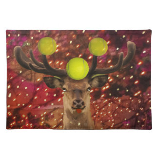 Deer with tennis balls in a shining forest . placemat