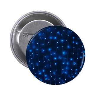 Defocused and blur image of garland of blue led li 6 cm round badge
