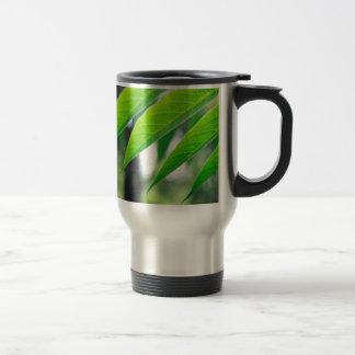 Defocused and blurred branch ailanthus travel mug