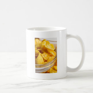 Defocused and blurred image of dry corn flakes coffee mug