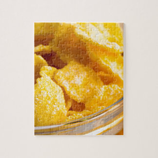 Defocused and blurred image of dry corn flakes jigsaw puzzle
