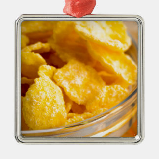 Defocused and blurred image of dry corn flakes metal ornament