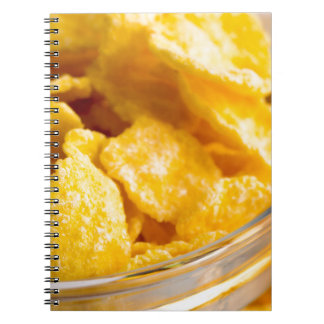 Defocused and blurred image of dry corn flakes notebook