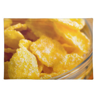 Defocused and blurred image of dry corn flakes placemat