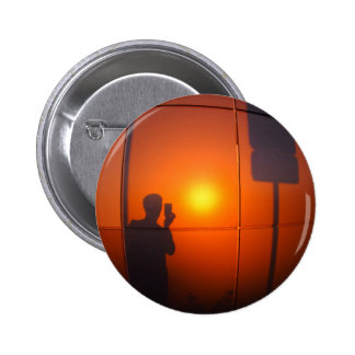 Defocused and blurry shadow of the man 6 cm round badge